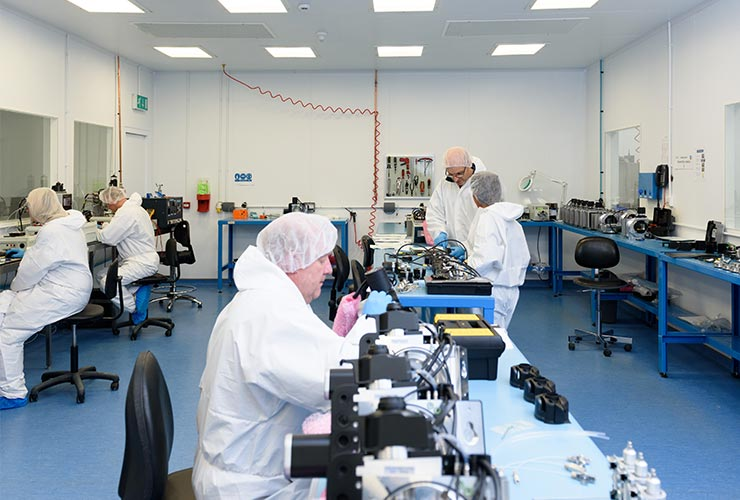 schivo employees working in one of our two ISO certified cleanrooms