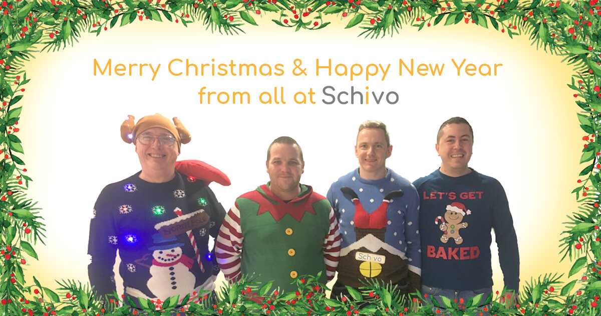 An image of four Schivo employees stepping-into-2019 wearing festive Christmas jumpers.